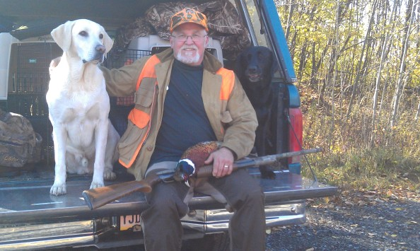Dan Surra rest after a great hunt on Pennsylvania's opening day of pheasant season
